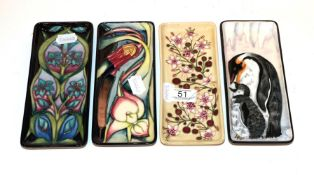 Four various Moorcroft pen trays . All first quality. 20cm by 8.5cm (x3), 20.5cm by 9cm. Three