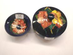A Walter Moorcroft miniature dish and bowl with cover (2). Both first quality. Both with light