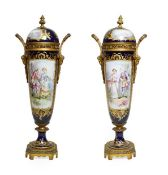 A Pair of Gilt Metal Mounted Sèvres Style Porcelain Vases and Covers, circa 1900, of slender