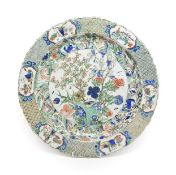 A Chinese Porcelain Charger, Kangxi, painted in famille verte enamels with foliage within