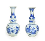 A Matched Pair of Chinese Porcelain Double Gourd Vases, Kangxi, with trumpet necks, painted in