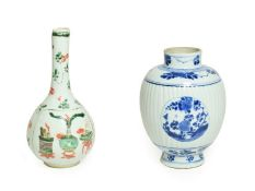 A Chinese Porcelain Vase, Kangxi, of fluted oval form with relief roundels, painted in underglaze