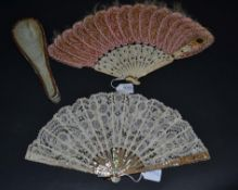 A Circa 1920's Pink Mother-of-Pearl Fan, the monture gilded, mounted with a Brussels tape lace leaf,
