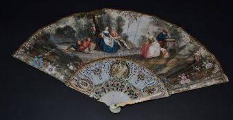 An 18th Century Ivory Fan, the slender monture carved, pierced and painted in colour, the gorge with