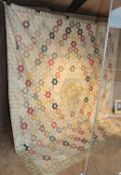 A Late 18th Century Silk Patchwork Bed Cover, with a central roundel enclosing a stylised sunburst