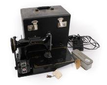A Circa 1950s 221K Black Singer Sewing Machine in a fitted case