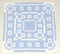 Early 20th Century Blue Floral Quilted Bed Cover, designed with white cotton squares and quilted