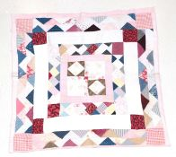 Late 19th Century North Country Thrift Quilt, designed in a mosaic pattern with central square, pink
