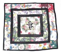Circa 1940s Patchwork, worked in black frames with a central diamond medallion incorporating