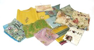 Assorted 18th Century and Later Silk Fabric Remnants, including a yellow silk fragment embroidered