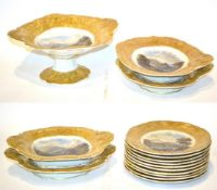 A Pratt-type part dessert service, decorated with landscape scenes within yellow and gilt borders