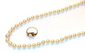 A single row cultured pearl necklace, length 50cm and a cultured pearl ring, indistinctly marked,