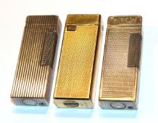 Two Dunhill lighters and another