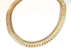 A 9 carat gold textured fringe necklace, 40cm long. Gross weight 19.75 grams.