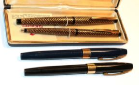 Three Sheaffer fountain pens and a ballpoint pen