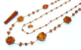 An amber bead necklace, formed of irregular shaped amber beads, length 86cm (approximately), another