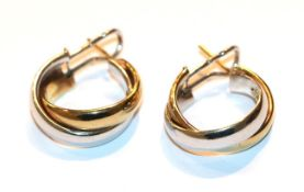 A pair of bi-colour hoop earrings, stamped '9KT', with post and clip fittings . Gross weight 9.14