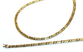A bi-colour fancy link necklace and bracelet suite, stamped '375', length 43cm and 18.5cm . Gross