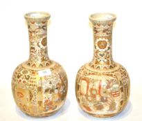 A pair of 20th Century Japanese Satsuma vases of bottle form, 31.5cm high . All over crazing to