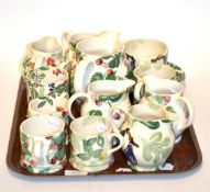 A collection of various Emma Bridgewater ceramics, comprising a cup and saucer, six jugs, five