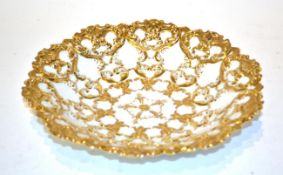 A 19th century Meissen relief moulded part gilt embellished dish, 23cm diameter . Wear to gilding