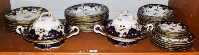 A Victorian cobalt blue and gilt highlighted part dinner service, including two tureens and