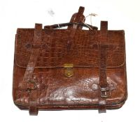 Brown crocodile briefcase, with modern lined and named lining, leather straps with buckles,