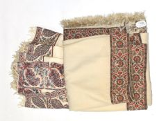 Large 19th century cream wool shawl with woven paisley trim, and another similar (both a.f.) (2)