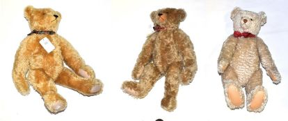 Large Steiff 1908 replica teddy bear with red and cream spotty bow tie; and two Atlantic teddy bears