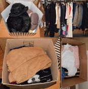 A quantity of circa 1960's and later ladies and gents clothing, including wool and striped suits,