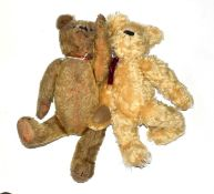 Circa 1930s yellow plush jointed teddy bear with boot button eyes, felt pads and a growler and