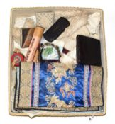 Assorted textile accessories including lace trims, sleeve ends, embroidered panels, Chinese silk