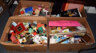 A large quantity of assorted scent samples, toiletries, including Chrisian Dior Dune and Poison
