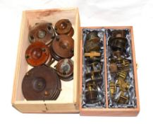 A Collection Of 16 Mainly Brass Plate And Crank Wind Reels along with 6 strap and starback wood
