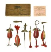 A Francis M Walbran Brown Trade Card Box containing a selection of various lures and Colorado type