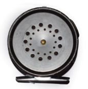 A Hardy Prefect 3 1/8'' RHW Trout Fly Reel with agate line guard.