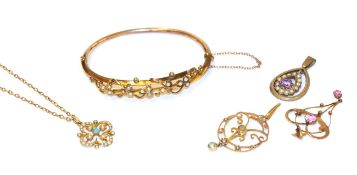 A collection of Edwardian jewellery including a hinged seed pearl bangle, of foliate design; a 9