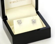 A pair of diamond cluster earrings, four princess cut diamonds in white claw settings, total