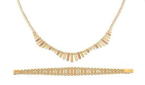 A 9 carat tri-coloured gold necklace, the central section of the necklace of textured undulating
