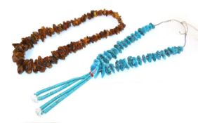 An amber necklace, the irregular shaped graduated amber beads as a continuous strand, length 71cm;