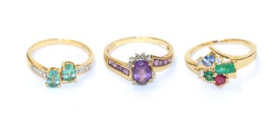 Three 9 carat gold gem set rings comprising of an amethyst and diamond cluster ring, finger size