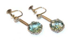 This Lot Is Being Sold On Behalf Of A Charity: A pair of blue zircon and diamond drop earrings,