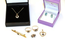 A collection of jewellery including a 9 carat gold sapphire and diamond heart pendant; a pair of 9