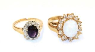 A 9 carat gold amethyst and diamond cluster ring, the oval cut amethyst within a border of eight-cut