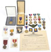 A Collection of Sixteen Various US Medals, including a boxed Purple Heart,