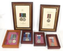 A Collection of Eight Rhodesian Service Medals:- Rhodesian GSM & Police LSGC with Bar Pair (11720