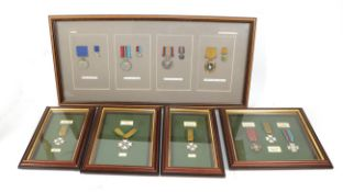 Five Glazed Displays of Rhodesian Medals:- District Service Medal, General Service Medal,