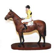 Beswick Connoisseur Horse 'Arkle - Pat Taaffe Up', model No. 2084, bay matt, on wooden plinth. A few