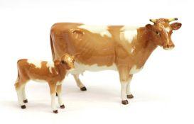 Beswick Guernsey Cow, first version, model No. 1248A and Guernsey Calf, model No. 1249A, golden