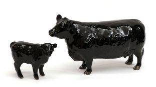 Beswick Aberdeen Angus Cow, model No. 1563 and Aberdeen Angus Calf, model No. 1827A, black gloss (